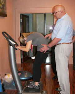 Dr Danilov the devloper of CN-NINM technology instructions a TBI patient on movement exercises